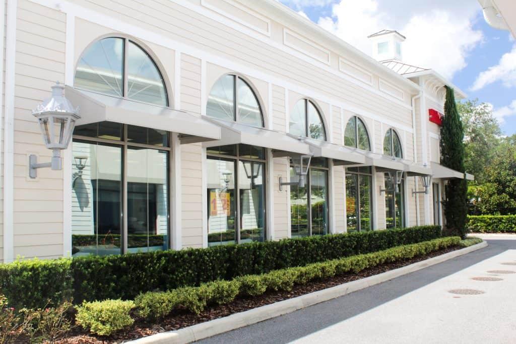 white metal awnings on retail building