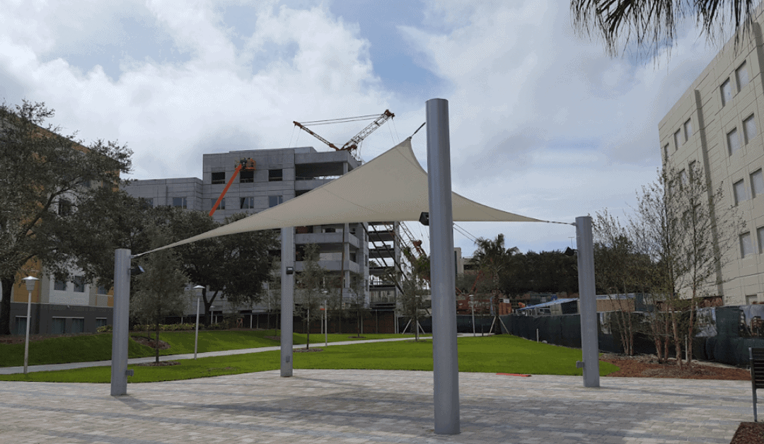 Read How Covered Walkways Improve Safety & Reduce Heat!
