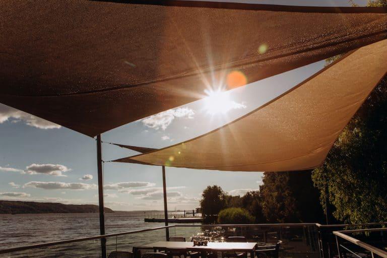 restaurant terrace seashore ray sun through awning